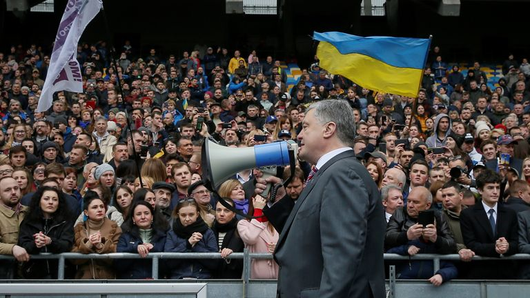 Mr Poroshenko, speaks to the crowd after a failed attempt to hold a debate