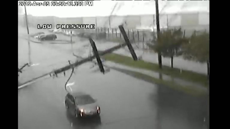 Falling power line crushes car