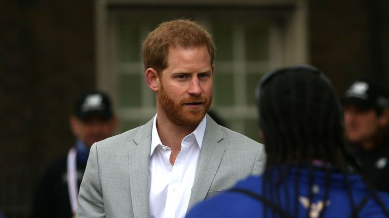 Prince Harry meeting a volunteer at the London marathon