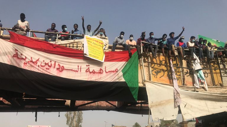Protesters chant slogans and carry national flags