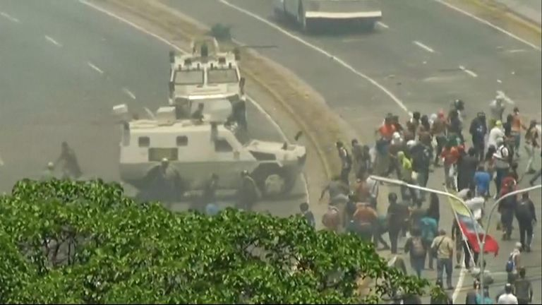 Military vehicles driven into a crowd of protesters in Caracus