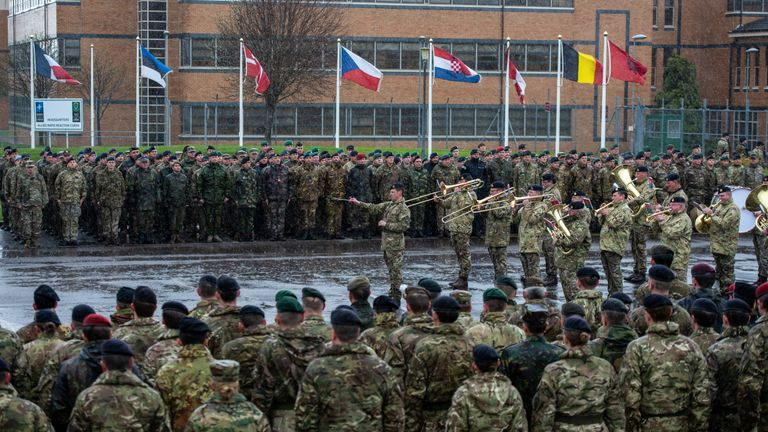 The Royal Artillery Band play in the rain during the NATO commemorative parade at Imjin Barracks on April 4, 2019 in Gloucester, England. This week NATO turns 70 years old. To celebrate, all 23 nations serving with the UK led NATO headquarters parade under their respective nation's flags at the NATO Allied Rapid Reaction Corps in Gloucester