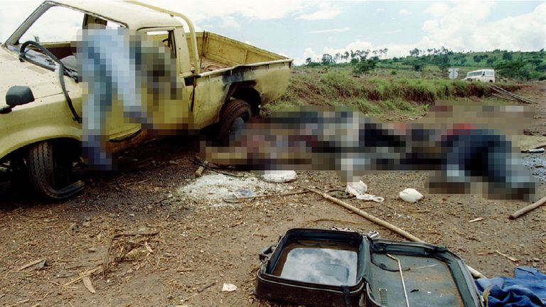 Dead Rwandans lie along the side of the road 8 May 1994