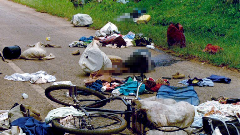Bodies lie among belongings and a bike discarded as victims attempted to flee the killing