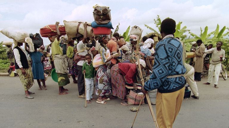 Hutu militiamen control 27 May 1994 fleeing Rwandans at a checkpoint 28kms south of Kigali. Thousands of people are leaving Kigali fearing that the rebels of the Rwandan Patriotic Front (RPF) who are marching on the capital will close the road to the interim government in Gitarame. (Photo credit should read ALEXANDER JOE/AFP/Getty Images)