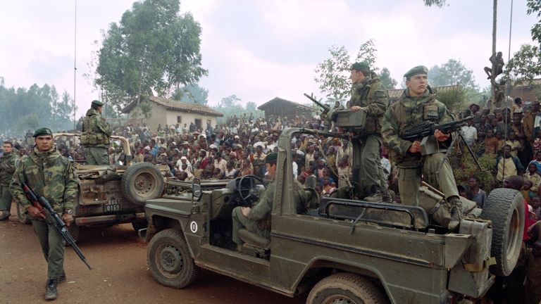 Rwandan Hutus welcome a French Marines detachment as they drive through a refugee camp, some 4kms outside Butare, on July 03, 1994. (Photo credit should read HOCINE ZAOURAR/AFP/Getty Images)