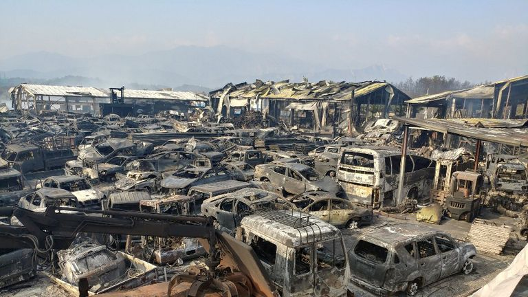 Burnt scrapped vehicles after a wildfire swept through a junkyard in Sokcho, South Korea