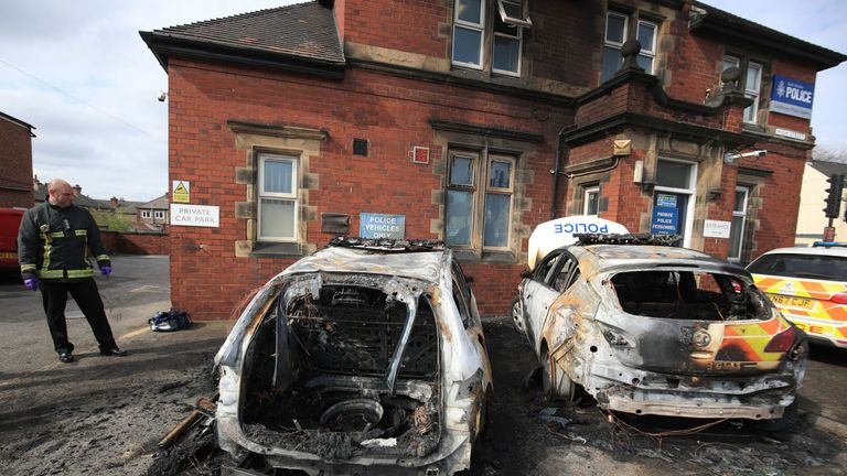 The police cars were set alight outside Goldthorpe police station in South Yorkshire