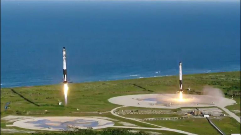 SpaceX shared this video showing the rocket's two reusable boosters successfully touching down after the launch.