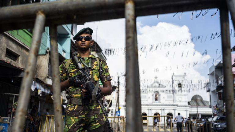 A Sri Lankan soldier stands guard at a barricade near St. Anthony's Shrine in Colombo