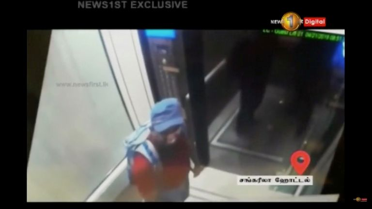 A man with a backpack is seen in Shangri La hotel elevator in Colombo