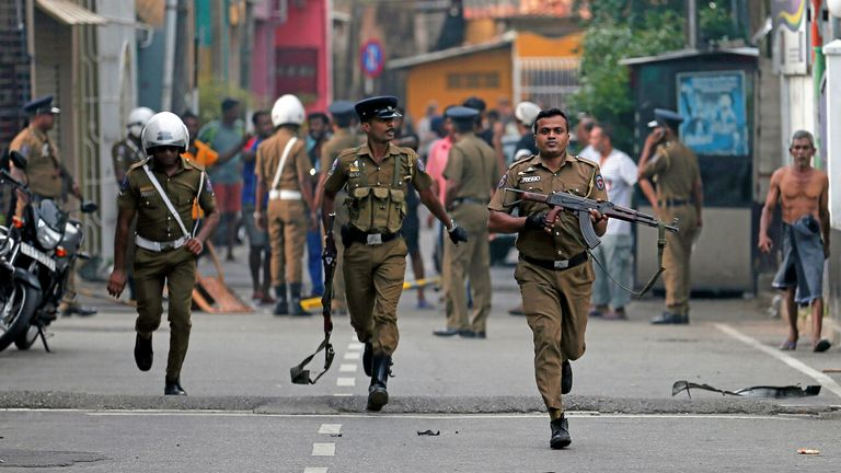 Sri Lankan police cleared the area while Special Bomb officers checked the site of the exploded van near a church attacked yesterday in Colombo, Sri Lanka 22 April 2019.