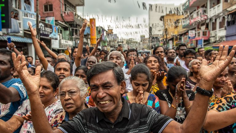 Sri Lankans pray in the street near St Anthony's Shrine