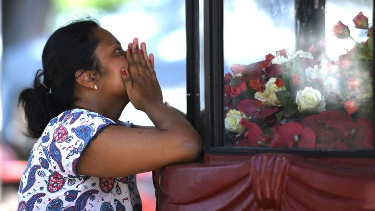 A woman prays at St. Sebastian's Church in Negombo