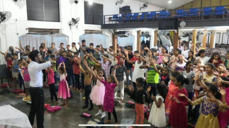 Children are among those celebrating Easter Sunday at a Sri Lankan church just before it is ripped apart by a bomb