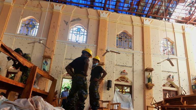 The damage inside St Sebastian's Church following Sunday's attacks.