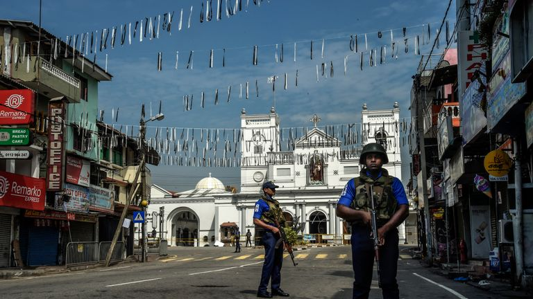 Security personnel stand guard at St Anthony's Church in Colombo