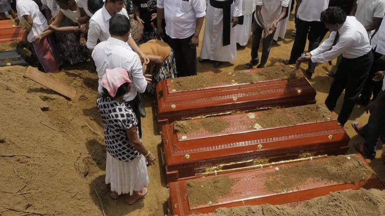 Relatives covered the coffins with earth