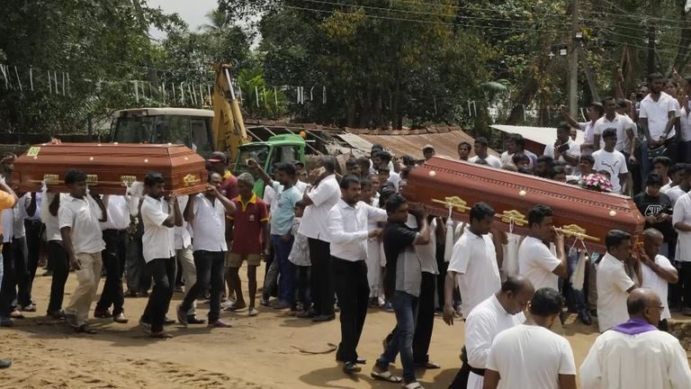 Families carried the coffins into the mass grave