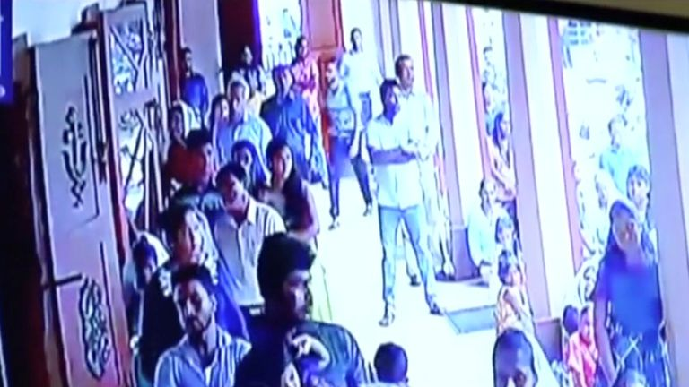 A suspected suicide bomber enters St Sebastian's Church in Negombo