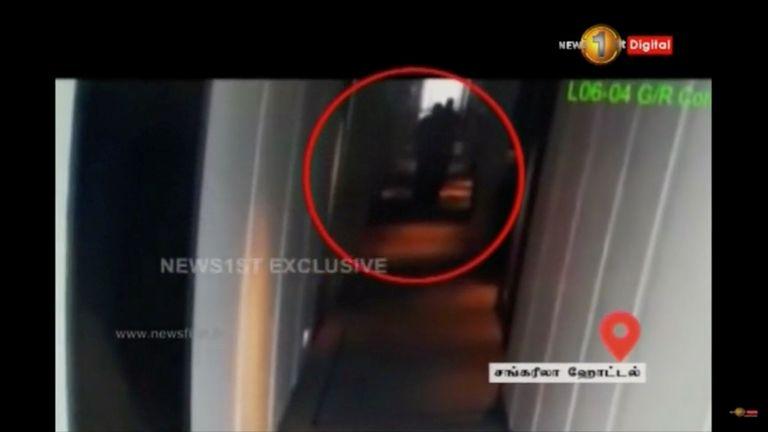A man walks in Shangri La hotel corridor in Colombo