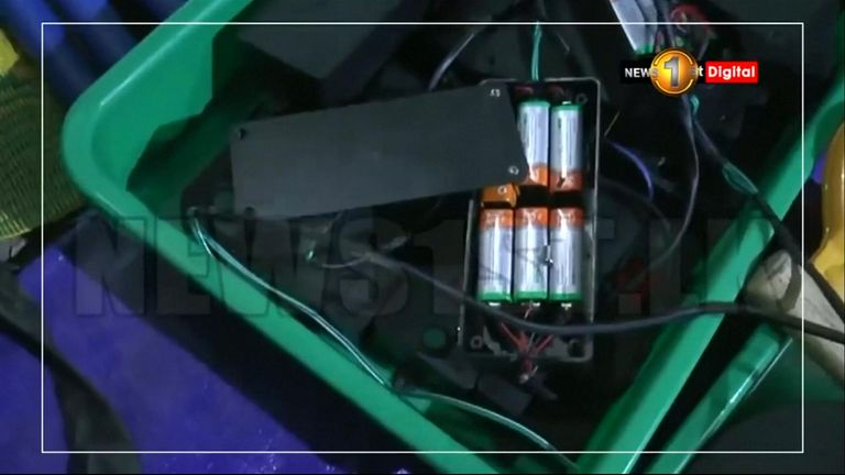 What look like batteries were found at the suspected bomb factory