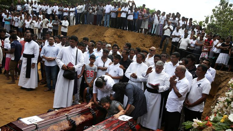 A mass burial of victims, two days after a string of suicide bomb attacks on churches and luxury hotels
