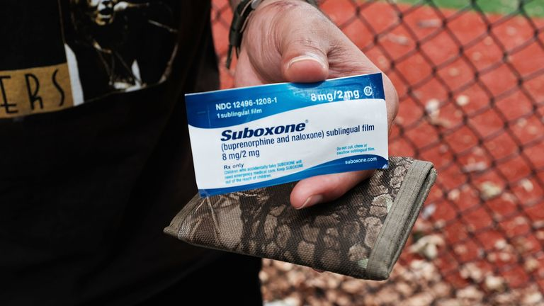 A heroin user holds suboxone near where John Jay College of Criminal Justice students are interviewing heroin users as part of a project to interview Bronx drug users in order to compile data about overdoses on August 8, 2017 in New York City