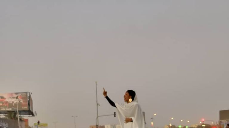 A Sudanese woman gestures during a protest demanding Sudanese President Omar Al-Bashir step down