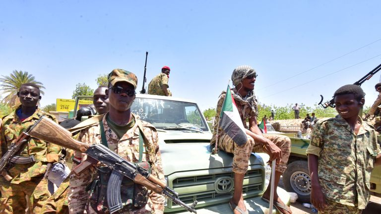 Sudanese armed forces gather near the site of a demonstration close to the military headquarters in the capital Khartoum