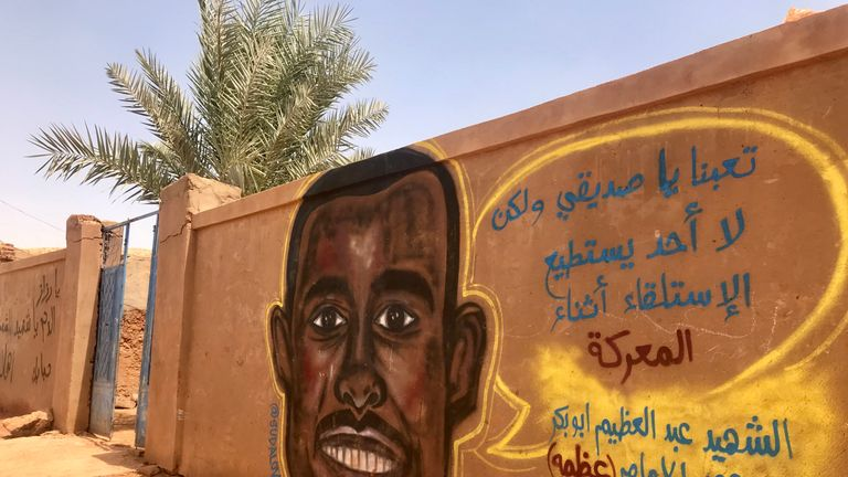 The mural of Abdulazim painted on a wall outside the family home
