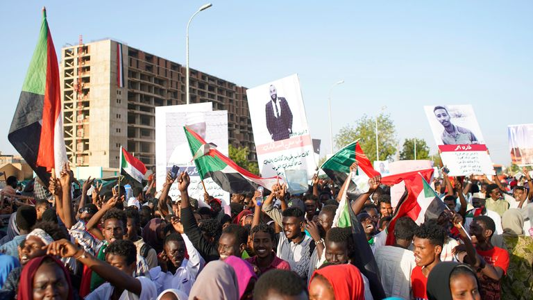 Sudanese demonstrators celebrate afterdefence Minister Awad Ibn Auf stepped down