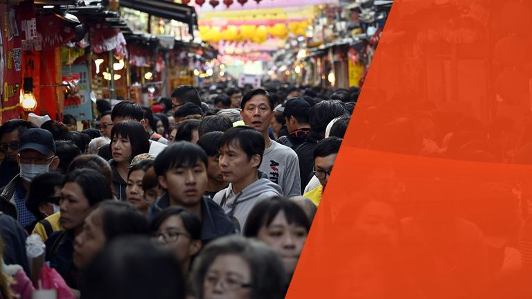This picture taken on January 25, 2019 showing people shopping at a traditional market on Di Hua street ahead of the coming Lunar New Year, this year the Year of the Pig, in Taipei. - The Lunar New Year will begin on February 4 and will mark the start of the Year of the Pig