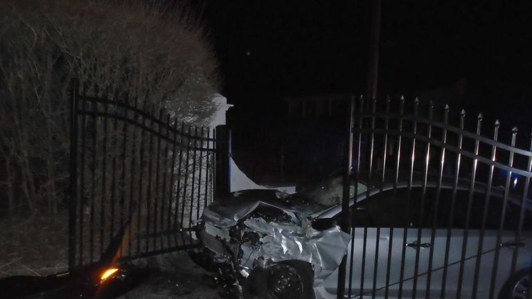 The car crashed into a wall before ricocheting into the gates of Swift's mansion. Pic: Hopkinton Police Department