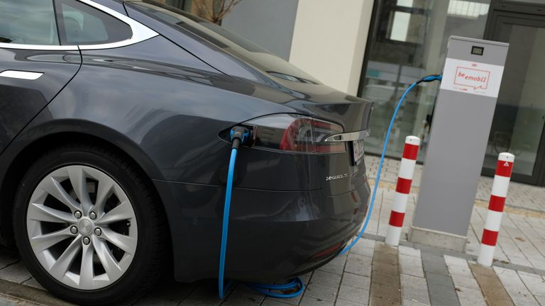 BERLIN, GERMANY - MARCH 02: A Tesla Model S electric car charges at a public charging column on March 2, 2019 in Berlin, Germany. Tesla recently announced it is closing many of its car showrooms in an effort to bring down costs as well as the price of its new Model 3. (Photo by Sean Gallup/Getty Images)
