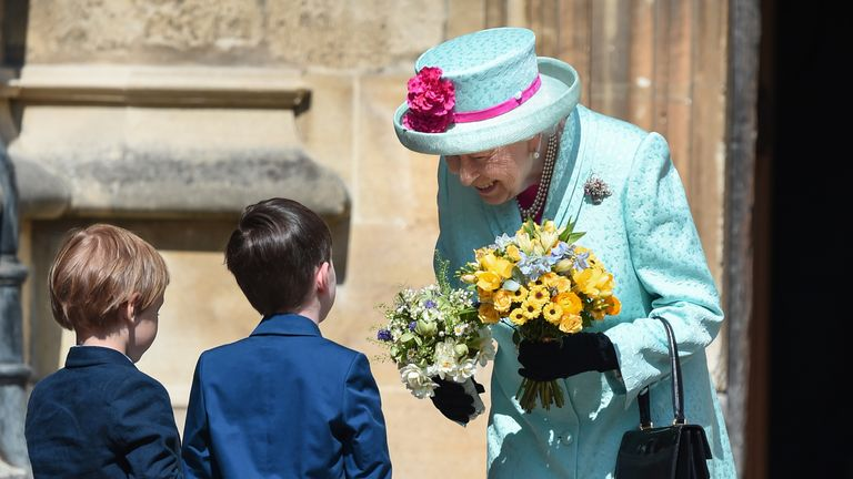 The Queen wore a matching light blue coat and hat with a pink ribbon for the annual Easter service