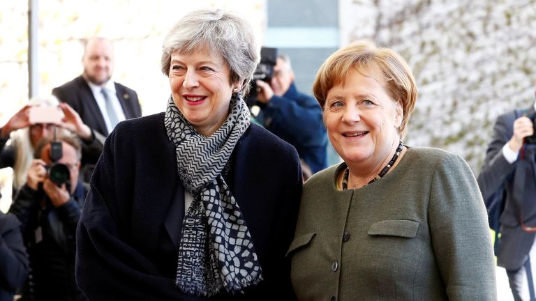 Theresa May is welcomed by German Chancellor Angela Merkel, as they meet to discuss Brexit, at the chancellery in Berlin