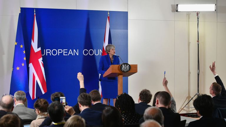Theresa May speaks at a news conference at the European Union Council headquarters in Brussels