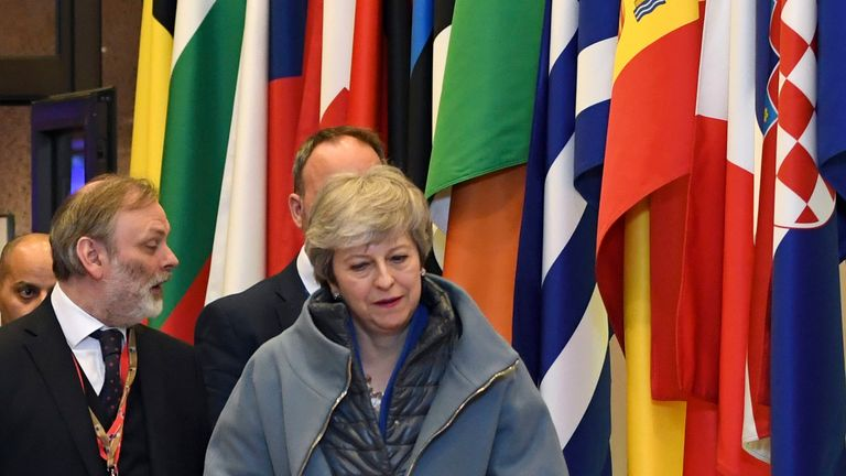 Theresa May leaves at the conclusion of an EU summit in Brussels