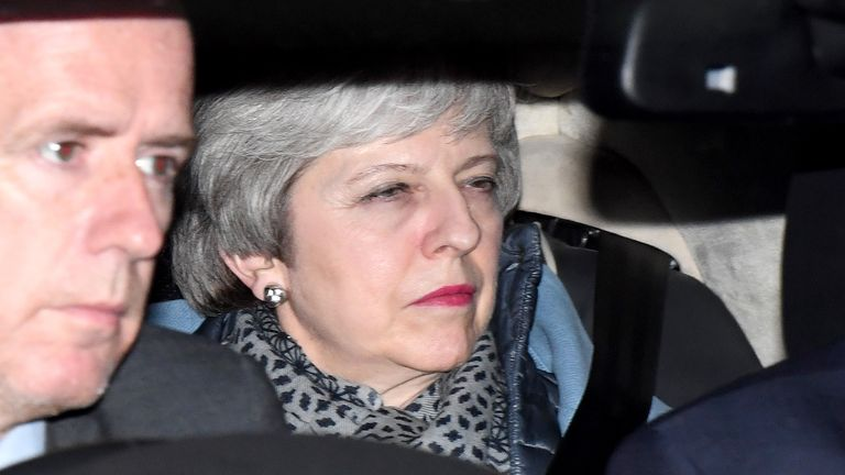 Theresa May leaves the House of Commons after the votes