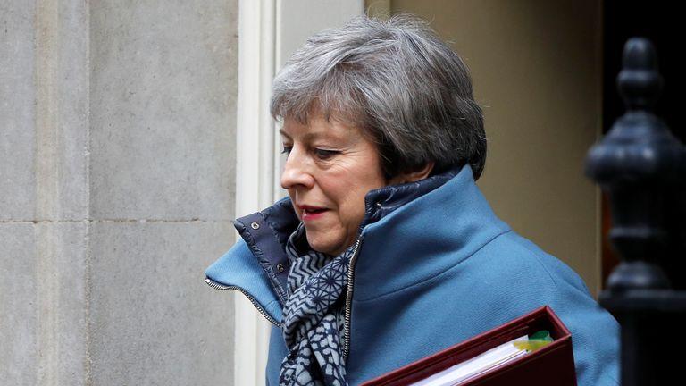 Theresa May leaves Downing Street