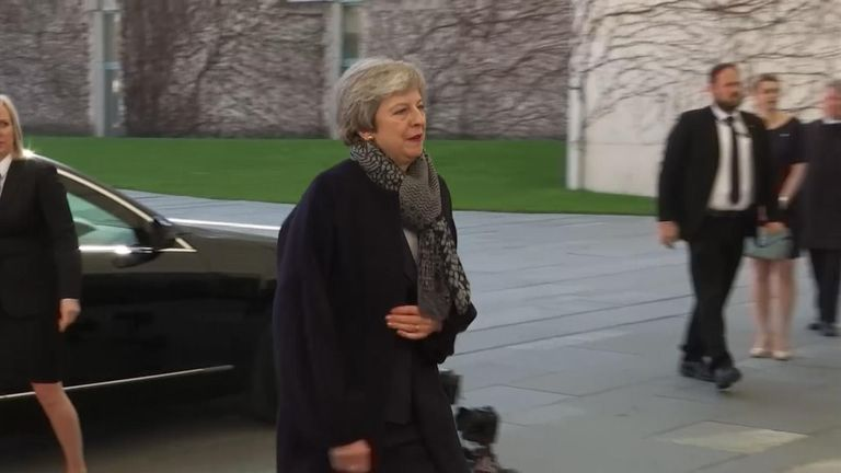 Theresa May arrives early to meet Merkel in Berlin