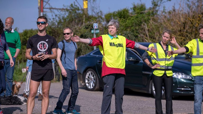 Theresa May dons high-vis vest to marshal Easter 10-mile race