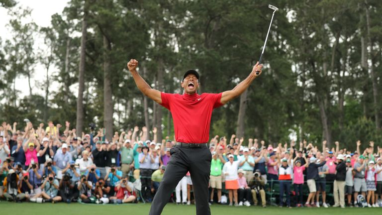 Woods celebrates his historic win