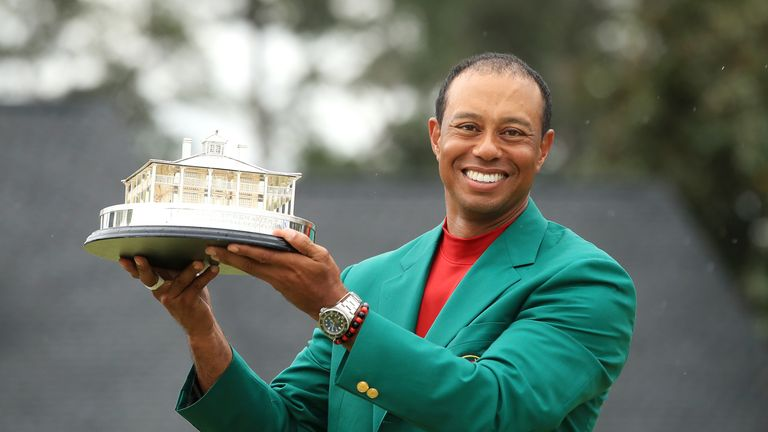 Woods poses with the Masters trophy