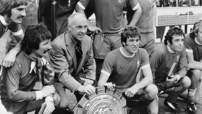 Liverpool with the 1974 Charity Shield after beating Leeds. L-R squatting: Tommy Smith, Bill Shankly, Emlyn Hughes and Ian Callaghan