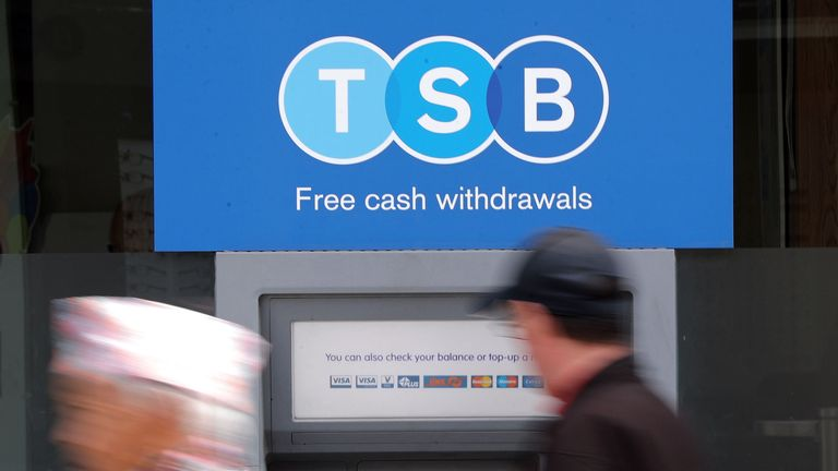 A man uses a TSB cash machine in Ashford, Kent