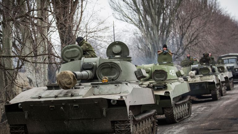 Pro-Russian rebels allegedly move tanks and heavy weaponry away from the front line of fighting in accordance with the Minsk II agreement