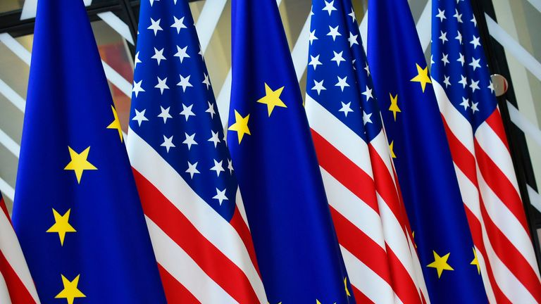 This photo taken on May 15, 2017 in Brussels shows US and European Union flags at the EU headquarters. US president Donald Trump will visit Brussels on May 25