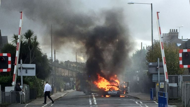 The vehicle burst into flames near a level crossing
